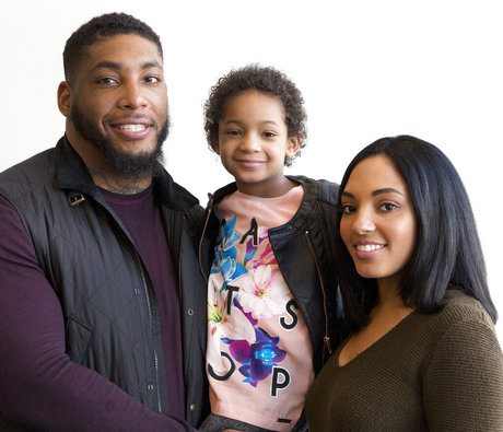 From left to right: Devon Still, daughter Leah, and fiancee Asha Joyce
